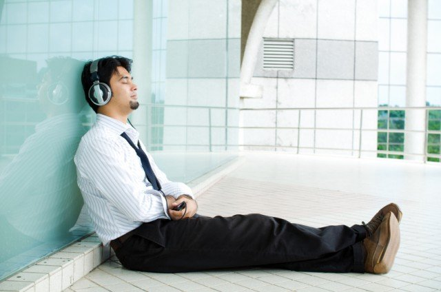 Man relaxing while listening to music