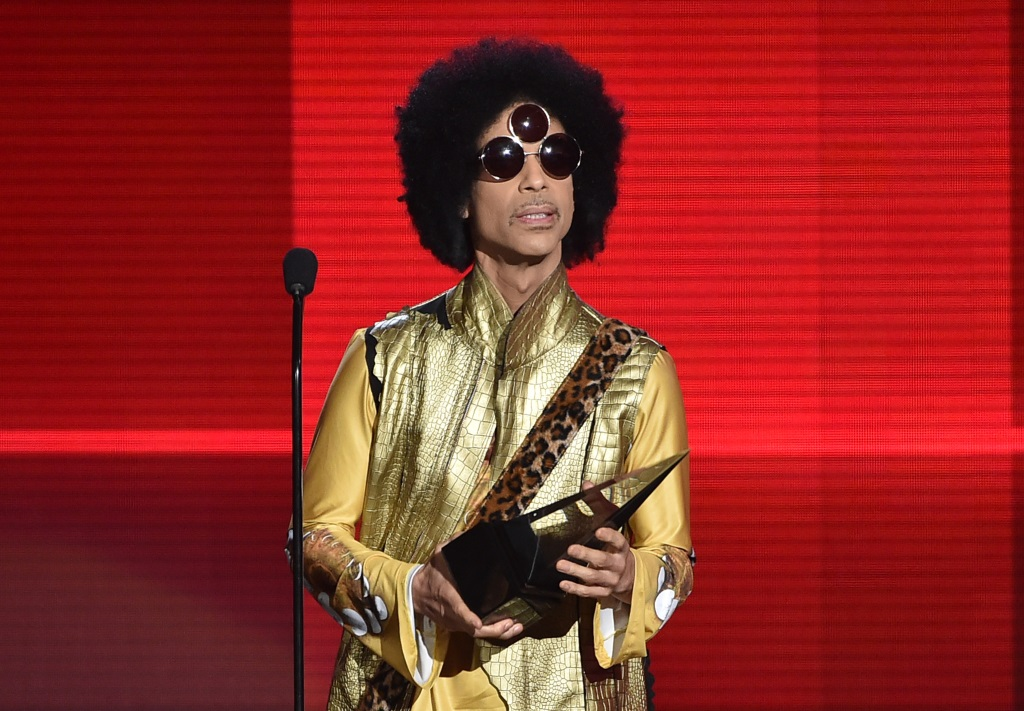 Prince accepts an award