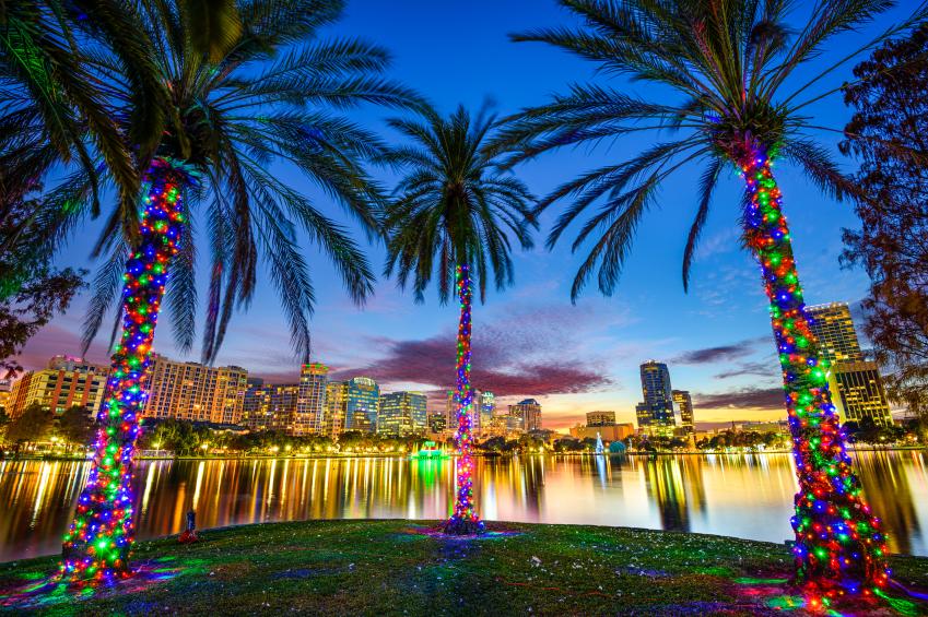 Orlando, Florida, USA downtown cityscape from Eola Lake.