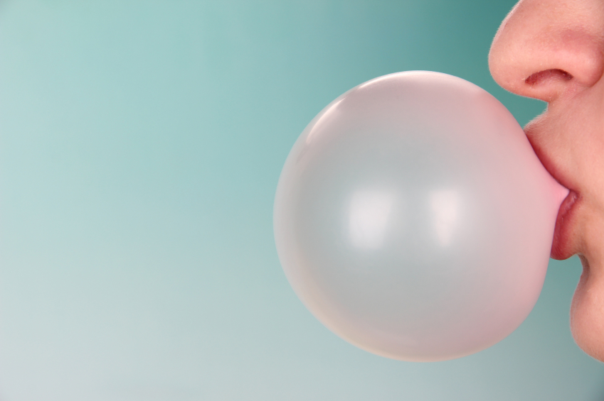 woman blowing a gum bubble