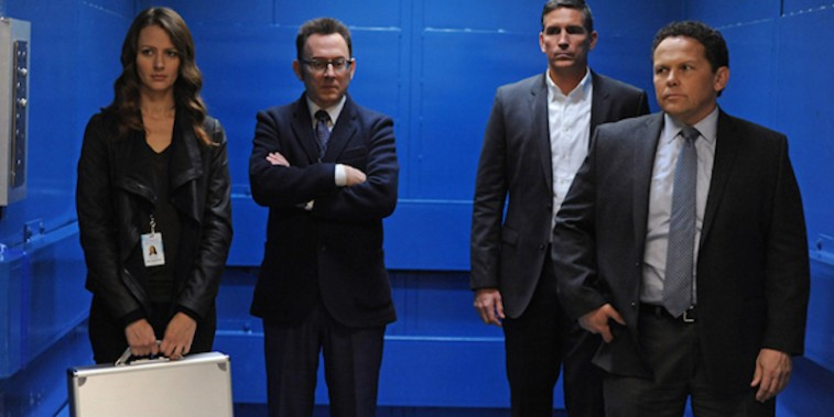 The cast stand together in a scene from Person of Interest