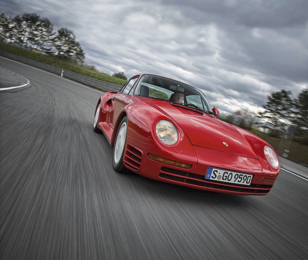 Red Porsche sports car, expensive celebrity cars