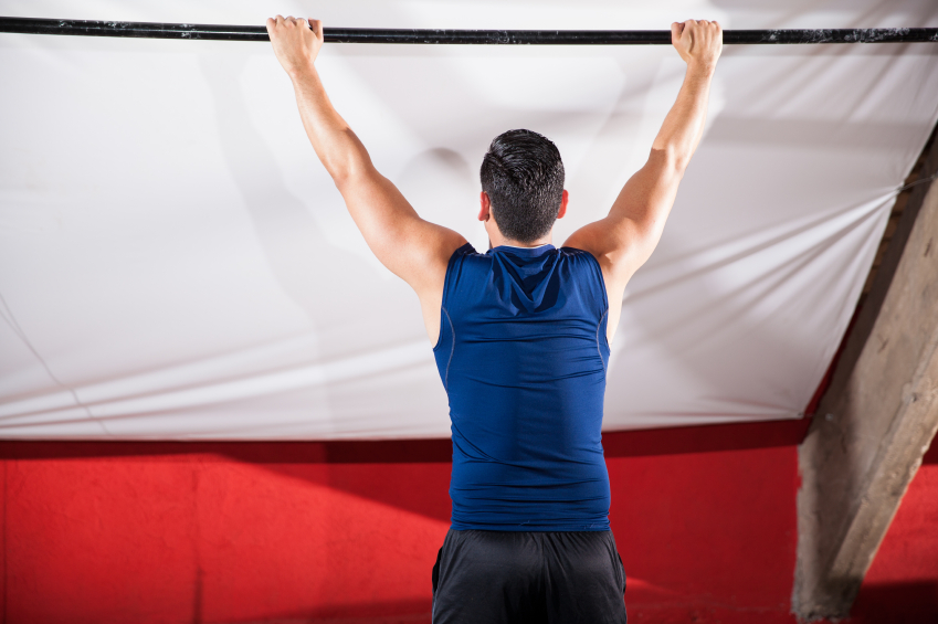 Man hanging from a pull-up bar