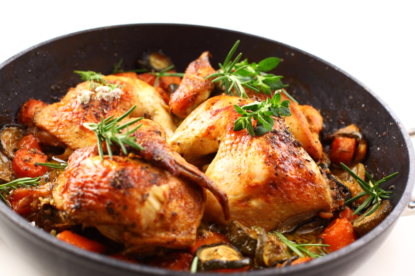 roasted chicken pieces and vegetables