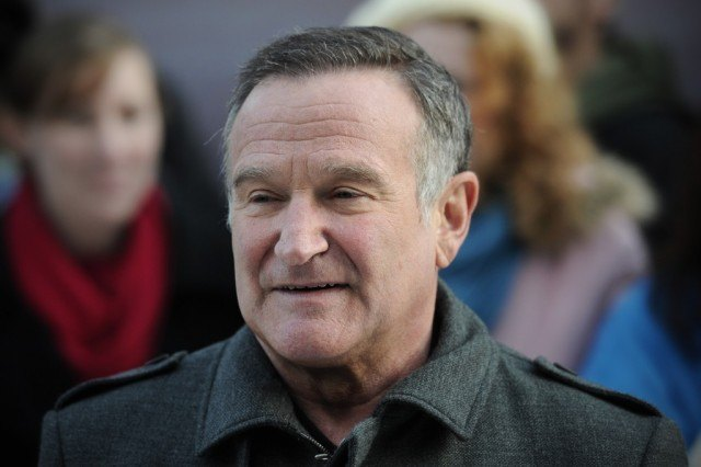 Robin Williams looking straight ahead and smiling.