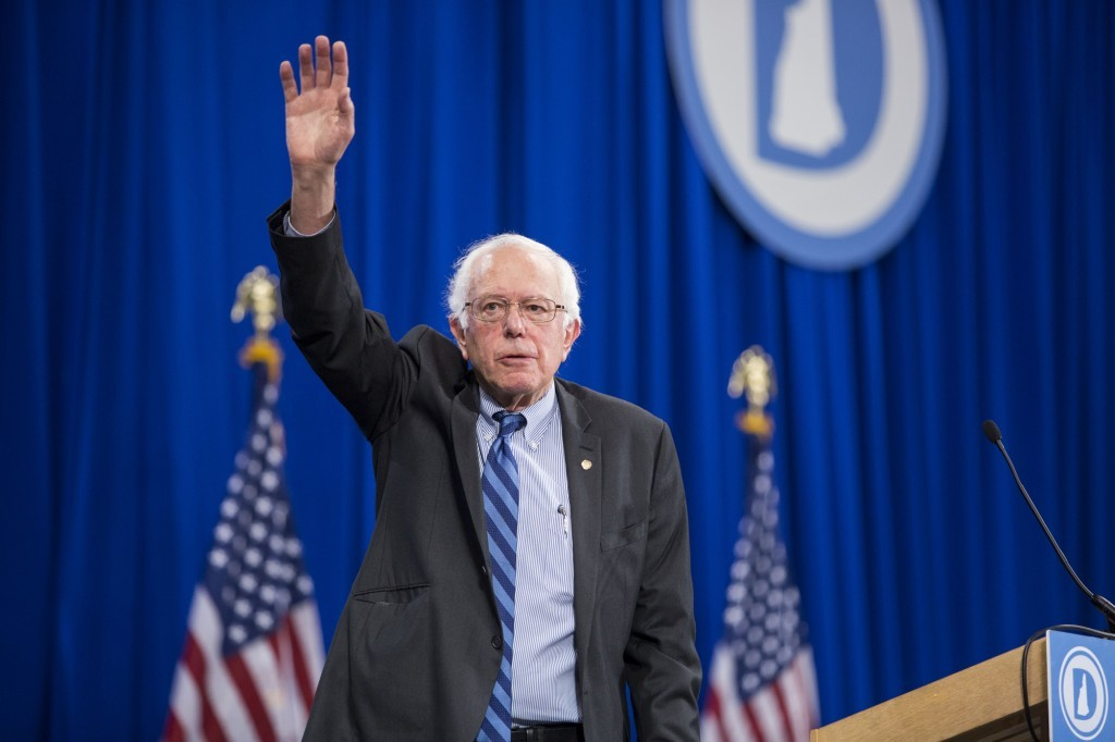 Bernie Sanders waving to audience