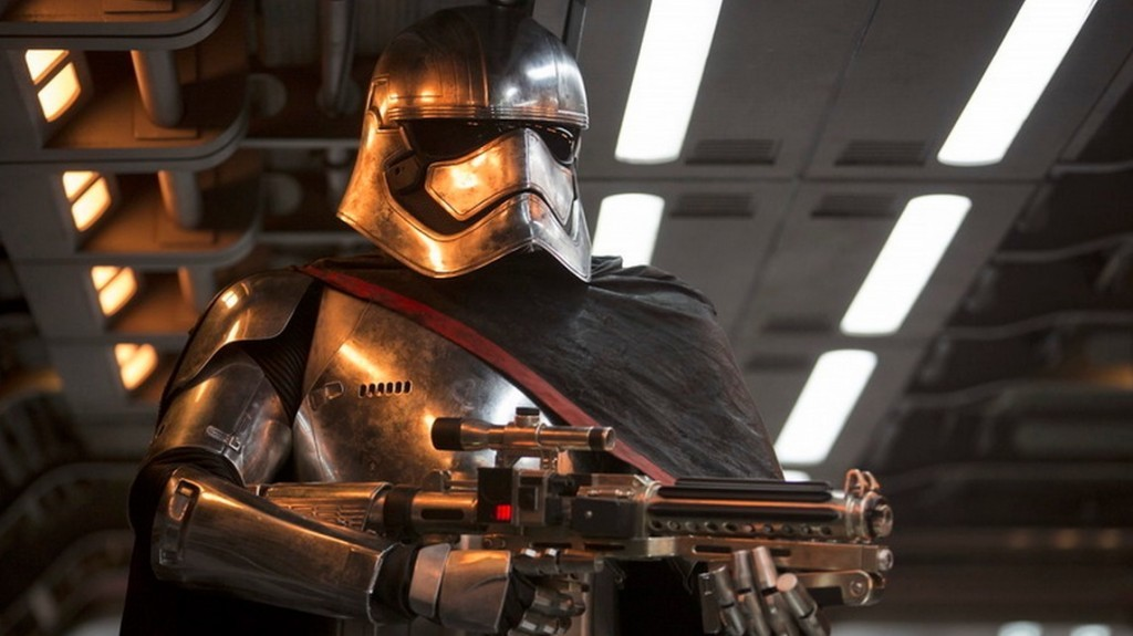 Captain Phasma holds up a weapon