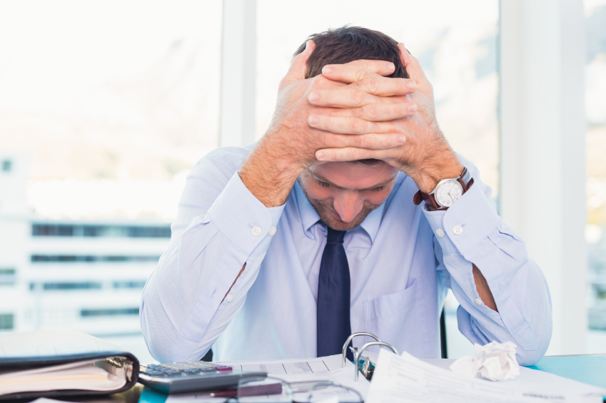 stressed office worker experiencing problems at work