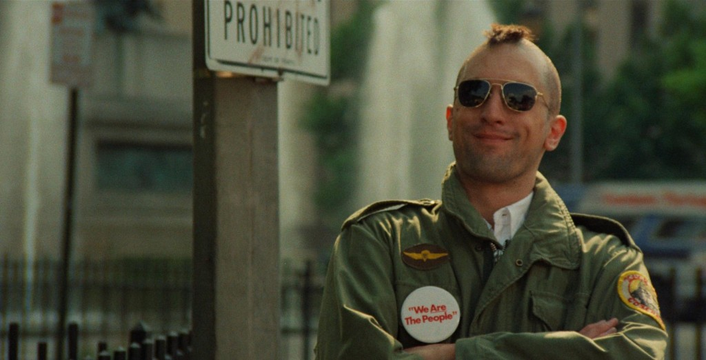 Robert De Niro smiles, wearing sunglasses and sporting a mohawk