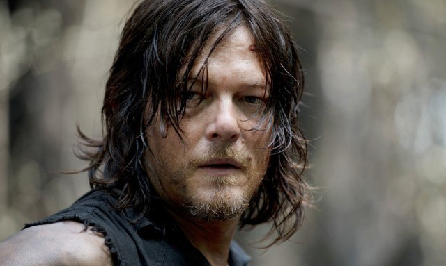 Daryl Dixon looking forward as he faces his torso to the side.
