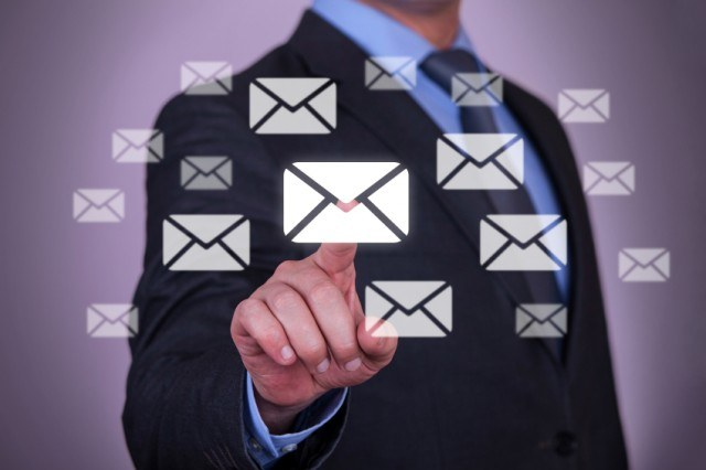Man pointing to email inbox