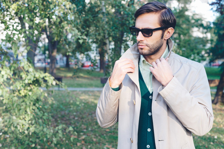 stylish man wearing trench coat in the spring