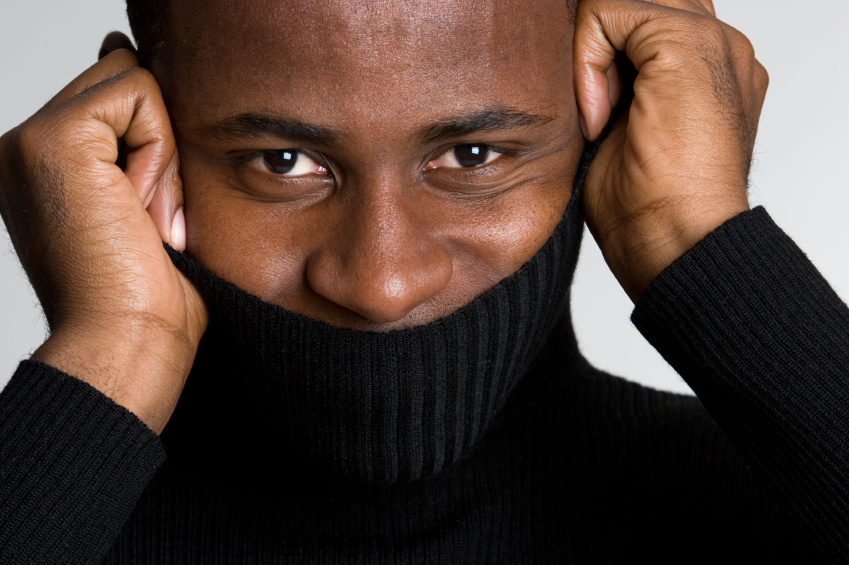 man smiling under a turtleneck