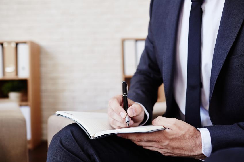 Member of management taking notes