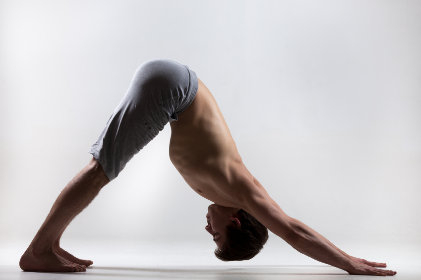 man in downward dog position