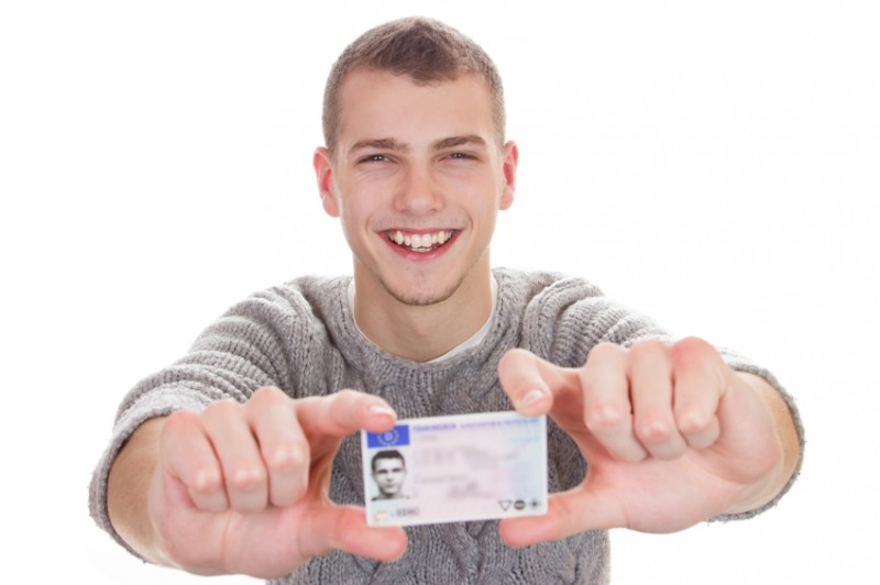 Young man showing driver's license