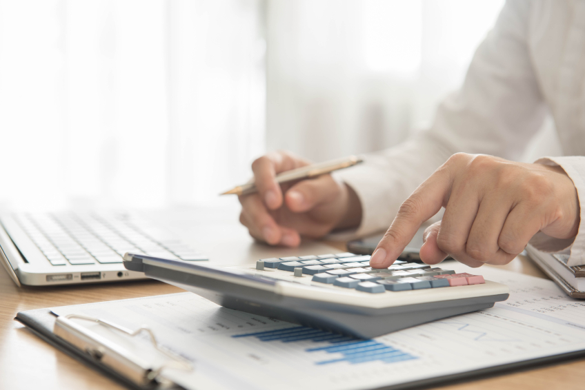An accounting professional crunching numbers