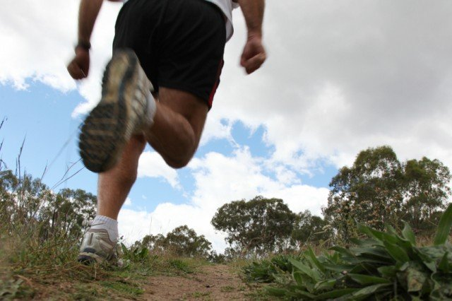 man running on a trail outside
