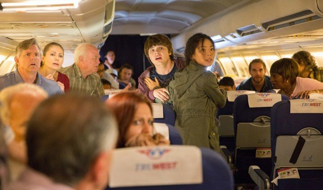 Jake (Brendan Meyer) and Alex (Michelle Ang) look frightened during a moment from the 'Fear the Walking Dead' web spinoff, 'Flight 462'