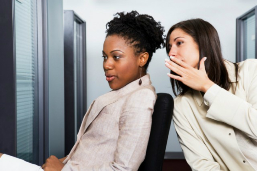 woman whispering at the office