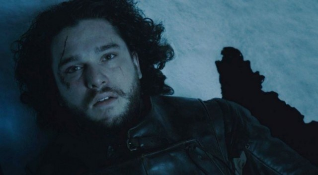 Jon Snow is lying in the snow dead and surrounded by blood.