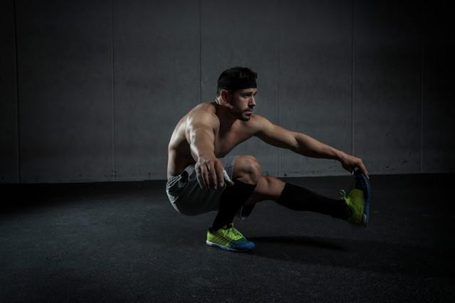 Man performing single-leg pistol squats