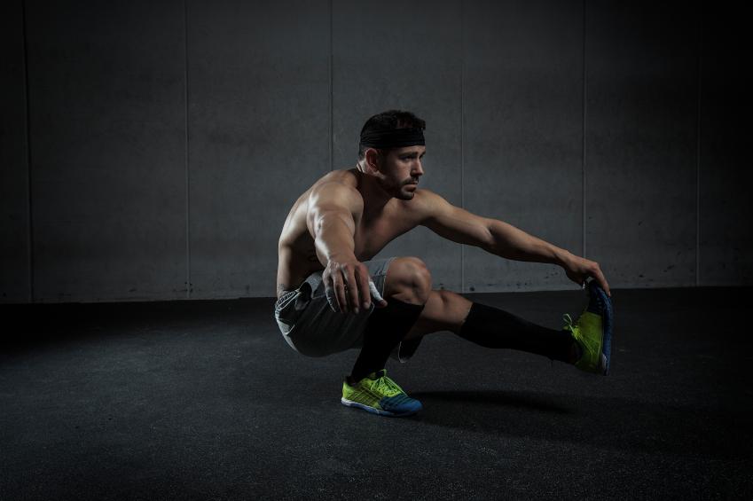 Man performing single-leg pistol squats