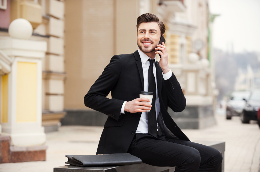 man in suit talking on phone