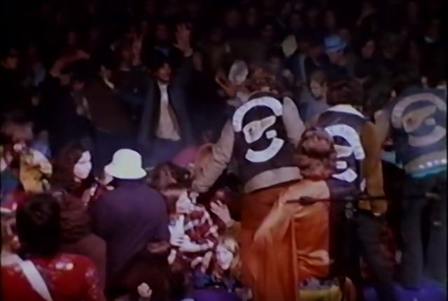 Hells Angels are approaching people in the audience of Altamont Free Concert.