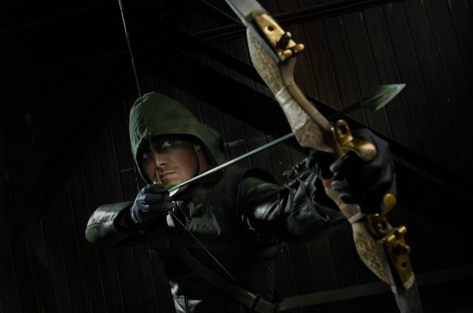 The Green arrow in his super-suit, preparing to fire an arrow
