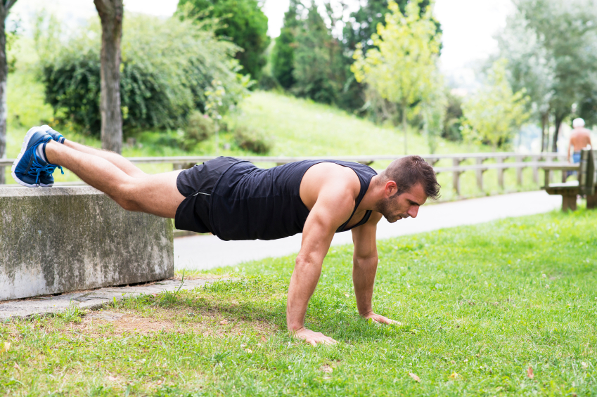 man doing push-ups with feet raised