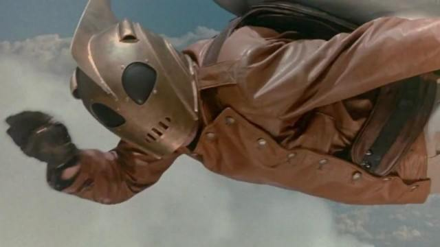 Billy Campbell as the Rocketeer wearing a mask and flying