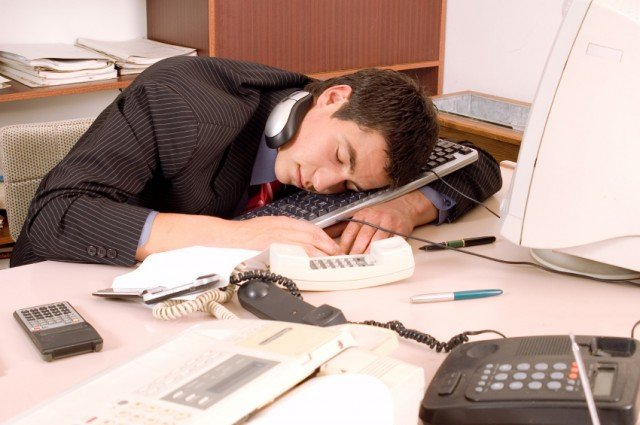 man sleeping at desk