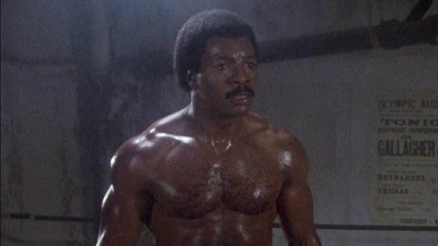 Carl Weathers is sweating and shirtless in the ring of Rocky III.