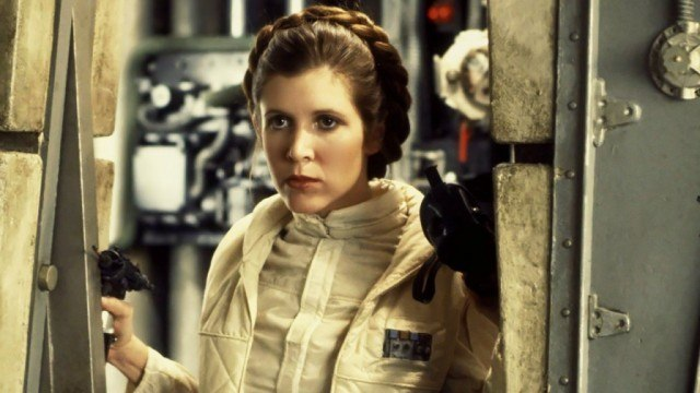 Princess Leia stands in front of a doorway.
