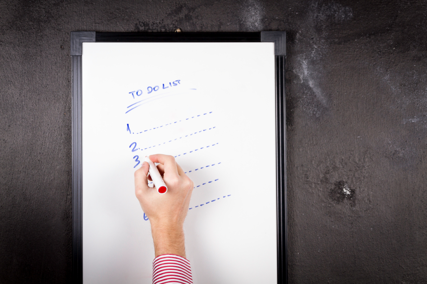 man checking off items on a to-do list