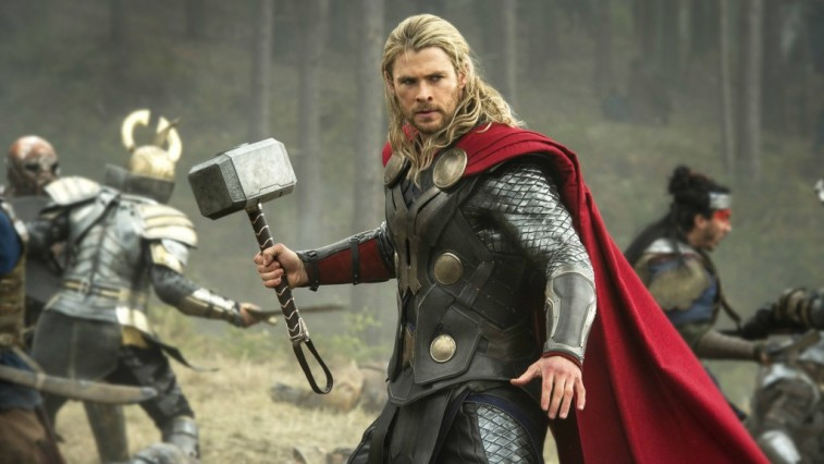Thor holds up a hammer