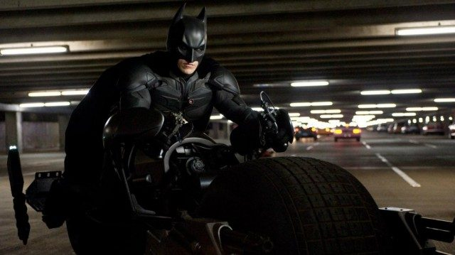 Batman rides a motorcycle in The Dark Knight