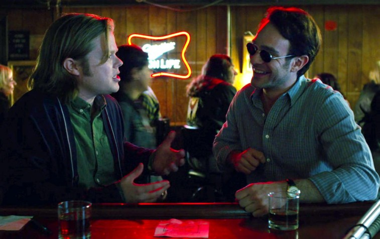 Foggy Nelson and Matt Murdock smiling together at a bar
