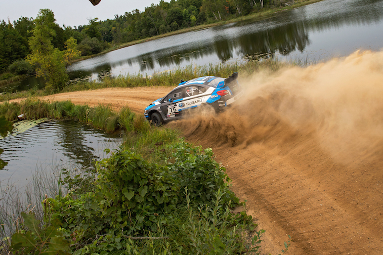 David-Higgins-and-codriver-Craig-Drew-sliding-between-lakes-in-northern-Minnesota-at-the-Ojibwe-Forest-Rally