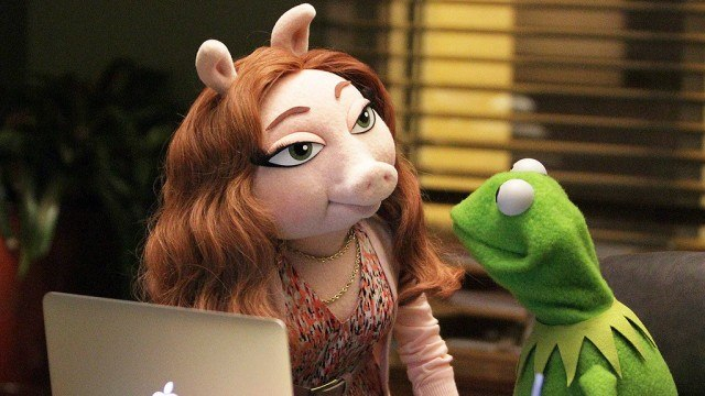 Denise and Kermit in 'The Muppets'