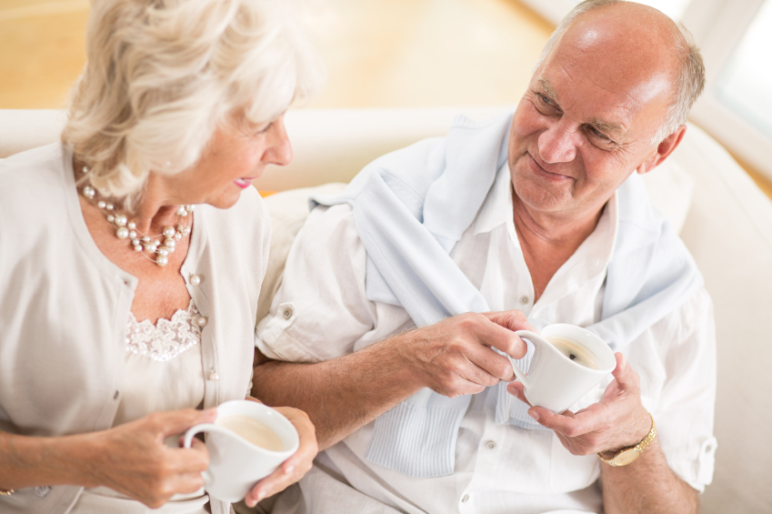 older couple talking and drinking coffee