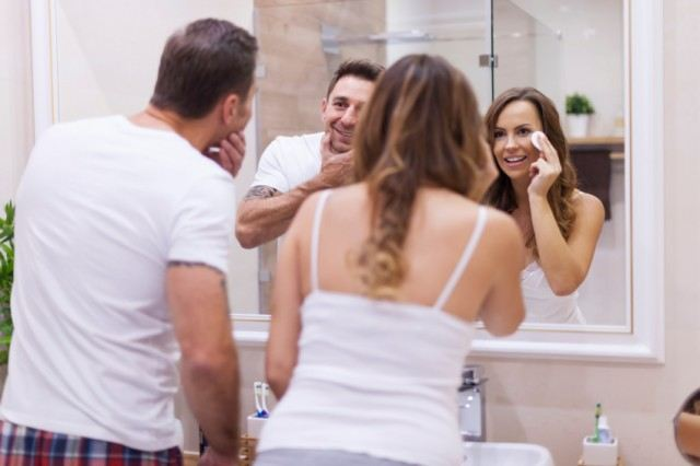 Man and woman washing their faces together