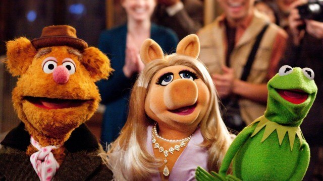 Fozzie, Miss Piggy and Kermit in 'The Muppets'.