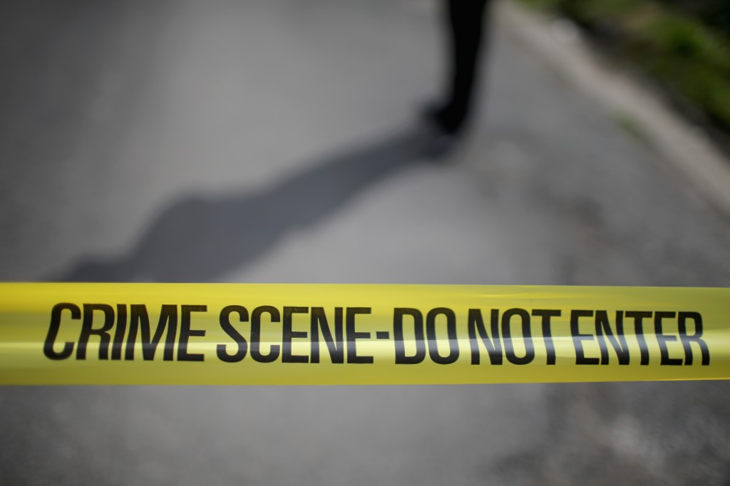 Crime scene tape at the site of an incident