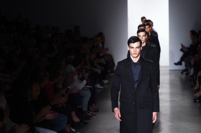 Audience applauding male models at the end of fashion show