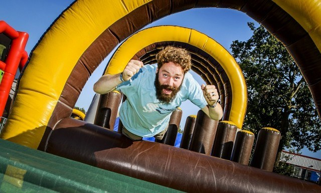 Man jumping on inflatables