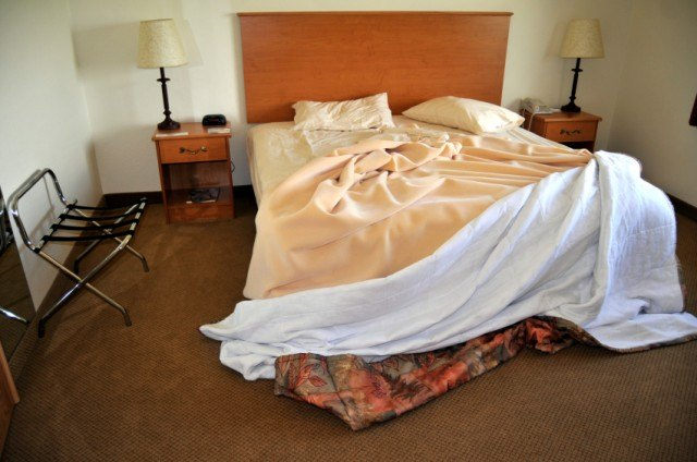 unmade bed in a hotel room
