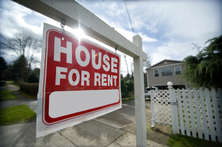 A house for rent sign on a rental property
