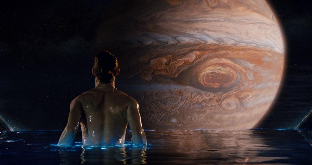 Man in a pool looking at jupiter in Jupiter Ascending
